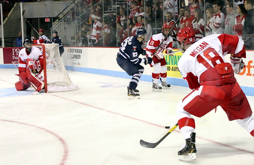 BU #18 Wade Megan takes a pass from #21 Sean Escobedo | by Odie M