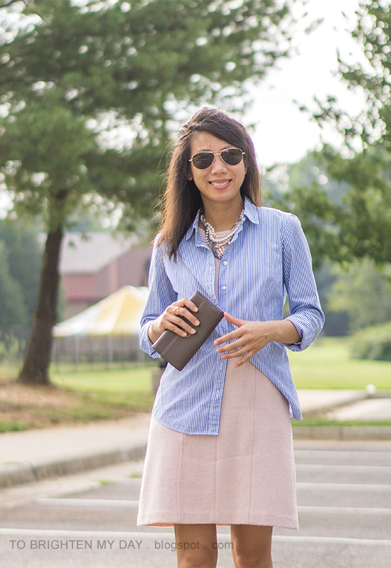 mixed metal necklace, blue striped button up shirt, pink wool shift dress, taupe clutch