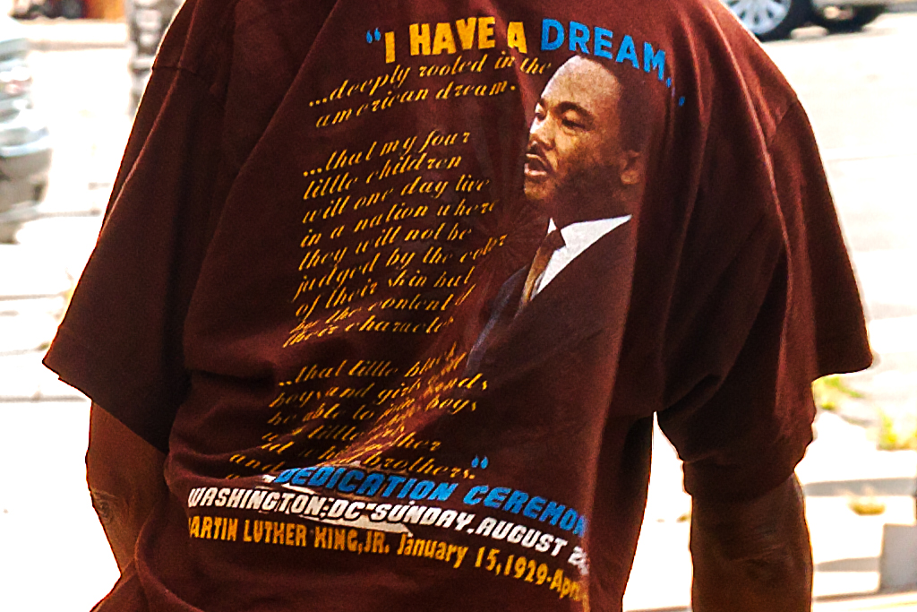 Man with cane wearing Martin Luter King T-shirt--Bella Vista (detail)
