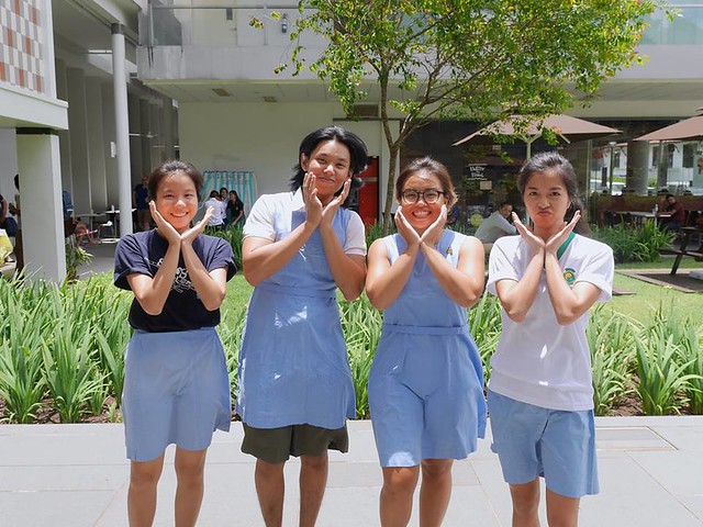 A brave young freshie, testing out the theory that pinafores are more comfortable than shorts. He looks quite happy though, so the theory might be accurate. Or it might be due to the fact that he's taking a picture with 3 girls, either way, he looks pleased.