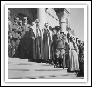 Emir Abdullah watching (with Sheikh Mutgal el Fiez) the procession for the wedding of his son Emir Talal ( Crown Prince ) to Princess Zein al-Sharaf bint Jamil ( later HM King Talal I of Jordan , Father of HM King Hussein of Jordan ) - circa 1934 | by DesertBlooms