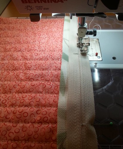 It's unusual for me to use my sewing machine after about 6pm, but I'm not able to concentrate on my knitting (or anything which requires doing the same thing for more than two minutes) so I'm putting the zips in the two cushion covers I'm making for Mam.