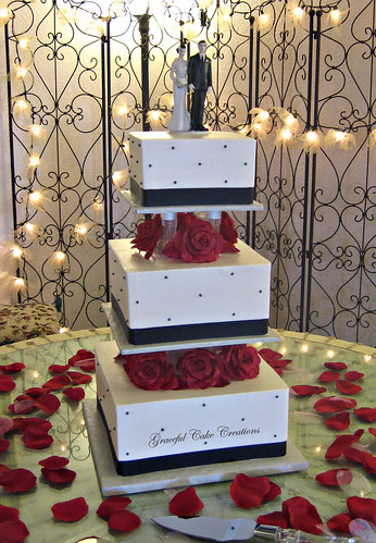 elegant square black and white wedding cake with red roses