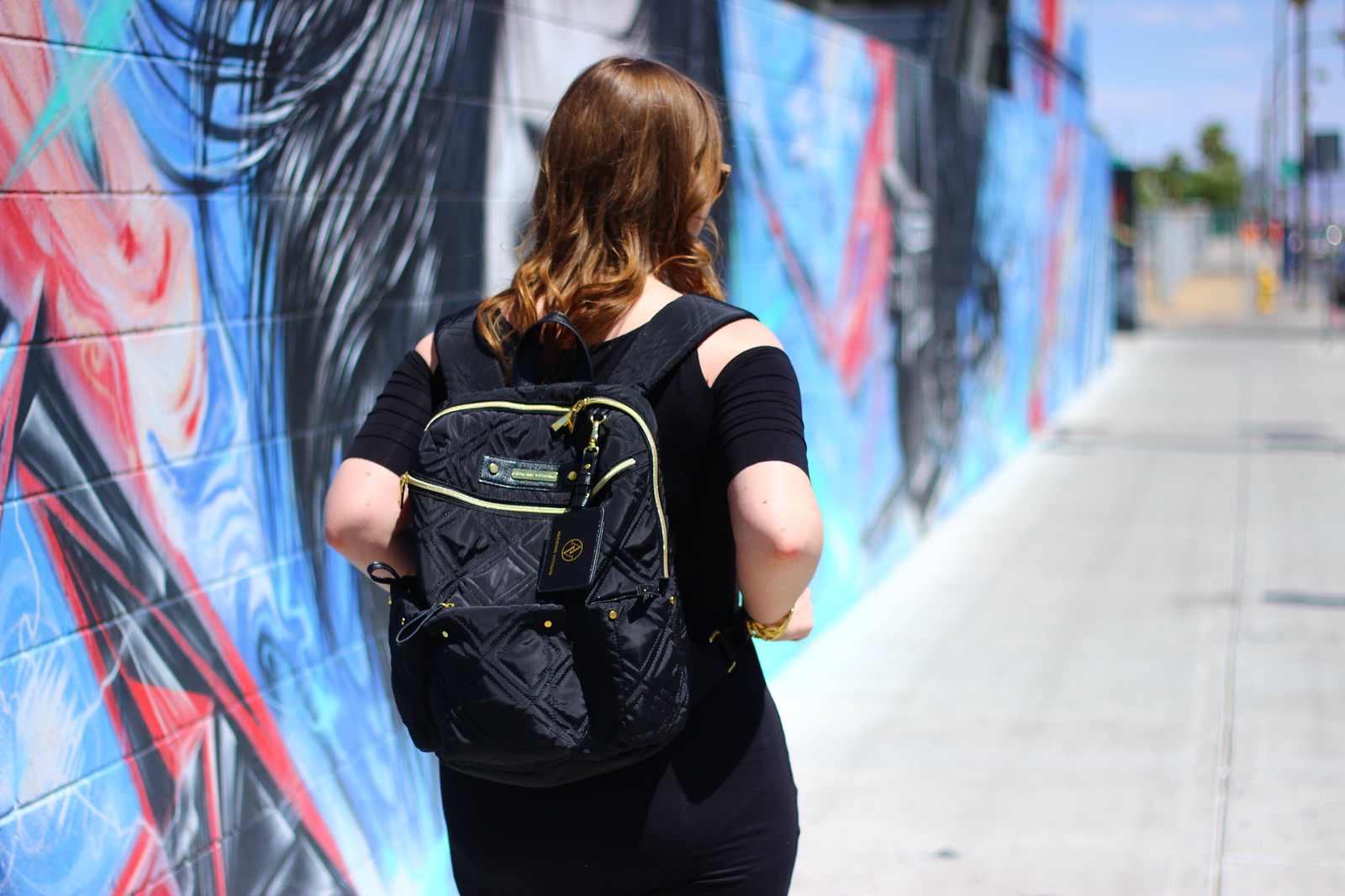 Black cold shoulder dress and black backpack