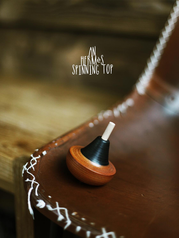 an hermes spinning top