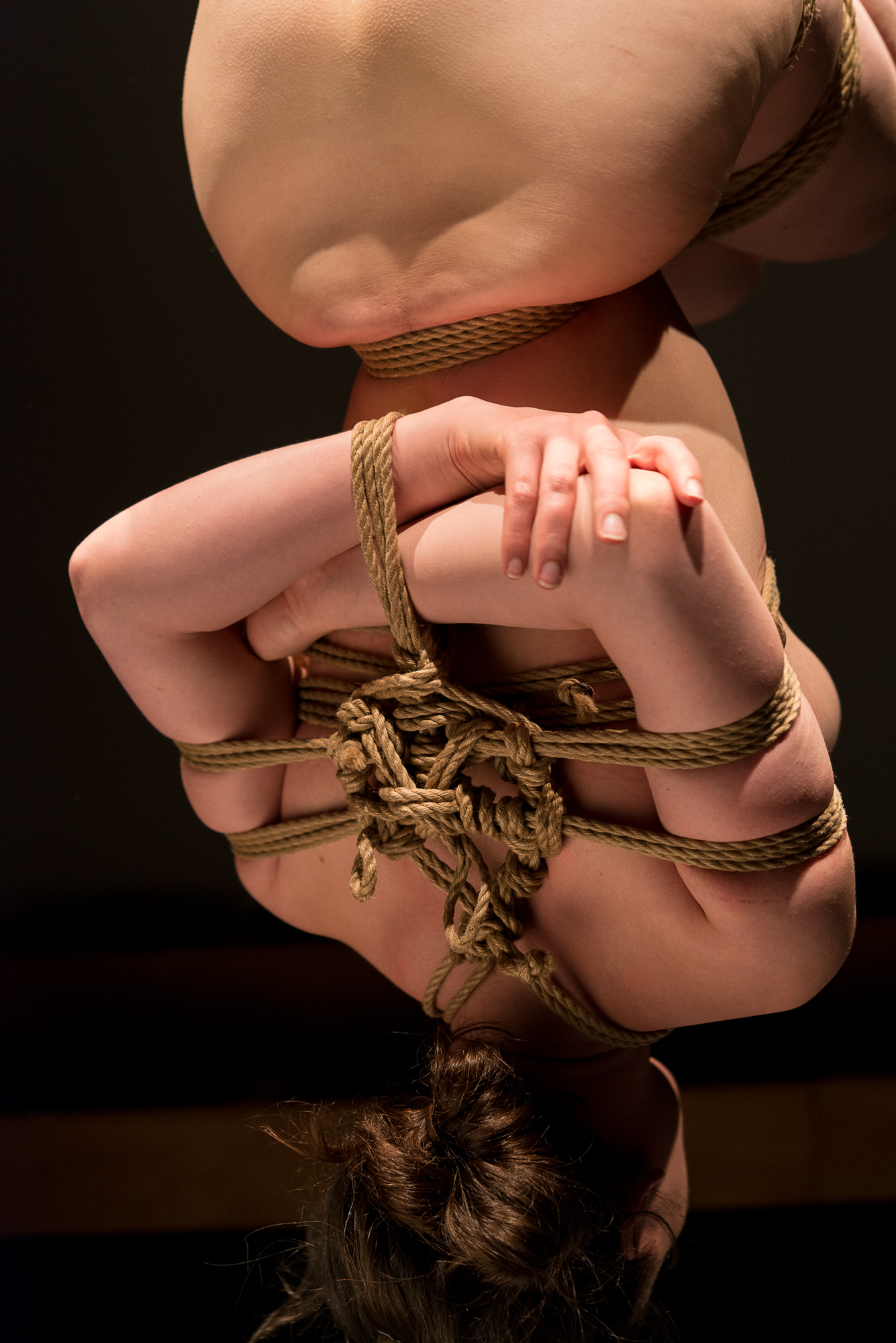 Gestalta in Sakasa-zuri, inverted suspension, during a shibari performance with Pedro
