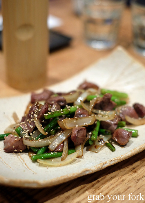 Stir-fried chicken giblets with garlic shoots at Hana Ju-Rin in Crows Nest Sydney