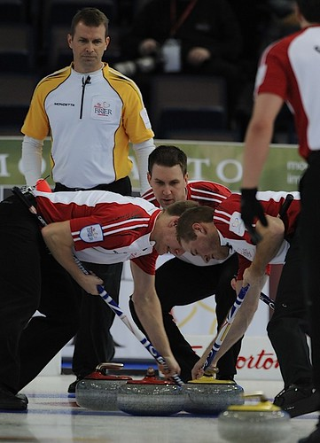 Edmonton Ab.Mar6,2013.Tim Hortons Brier.N.L. skip Brad Gushue,lead Geoff Walker,second Adam Casey.Manitoba skip Jeff Stoughton.CCA/michael burns photo | by seasonofchampions