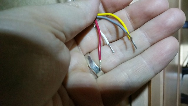 Red (12 VDC pos), Yellow (AC compressor signal), white (furnace signal) and grey (AC fan high speed) stripped