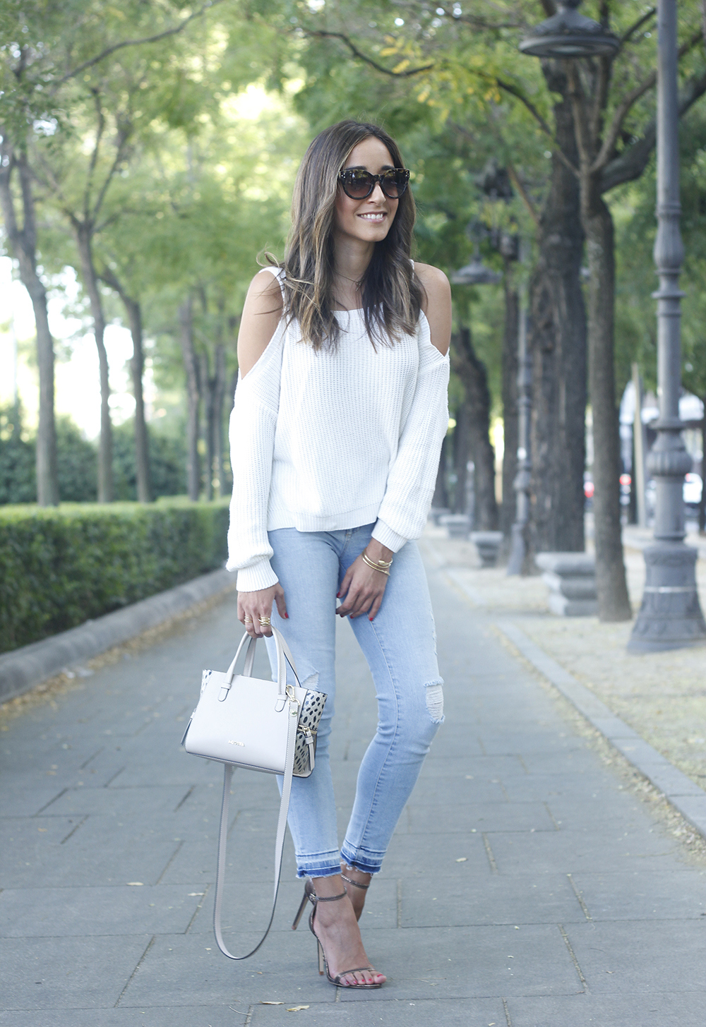 White off the shoulder sweater jeans acosta bag heels outfit style05