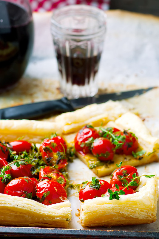 tart with cherry tomatoes and herbs