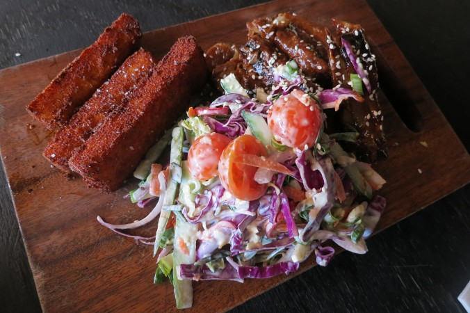 Spicy pork ribs with polenta chips & pear slaw