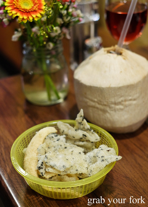 Black sesame rice crackers and fresh coconut juice at the Angie Hong dinner pop-up at White Taro in Surry Hills Sydney