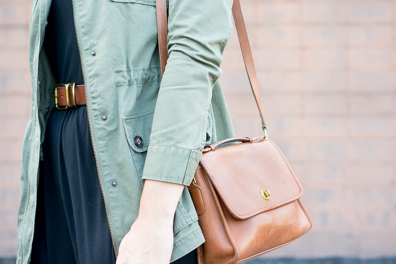 green utility jacket + black dress + scallop flats + cognac coach crossbody purse; casual fall outfit | Style On Target