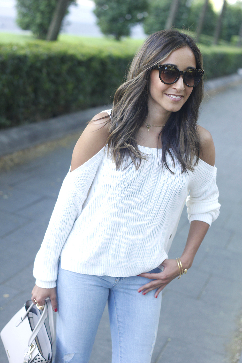 White off the shoulder sweater jeans acosta bag heels outfit style23