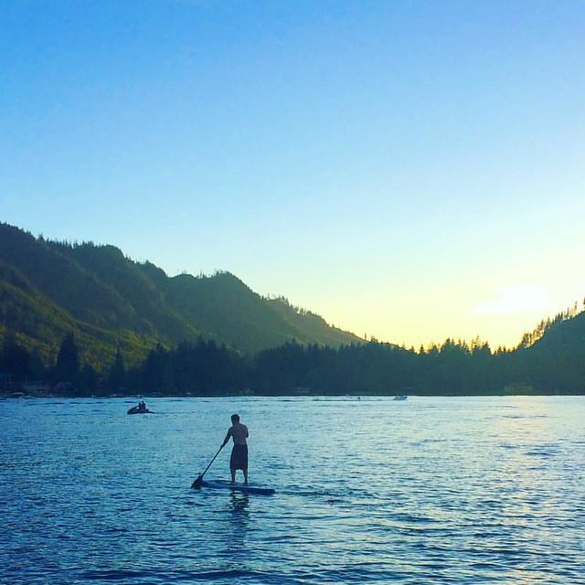 Joshy paddleboarding at sunset.