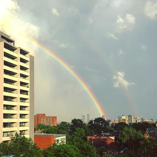 double rainbow in between rain showers