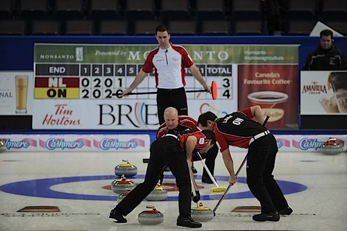 Edmonton Ab.Mar10,2013.Tim Hortons Brier.Ontario skip Glenn Howard,lead Craig Savill,second Brent Laing.N.L.skip Brad Gushue.CCA/michael burns photo | by seasonofchampions