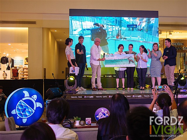 Co founder Rob (3rd from left) awards the Php 235,000 check to Bataan Tourism Council president Victoria Garcia