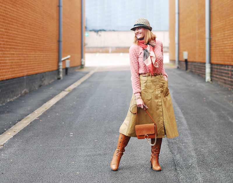 Autumnal layering with multi textures and soft colours: Camel midi skirt, pink textured sweater, tan knee boots, leopard print hat | Not Dressed As Lamb, over 40 style