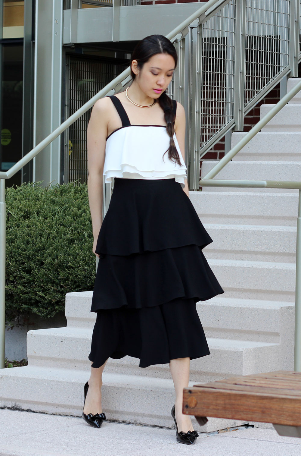 Black tiered ruffle skirt and bow heels