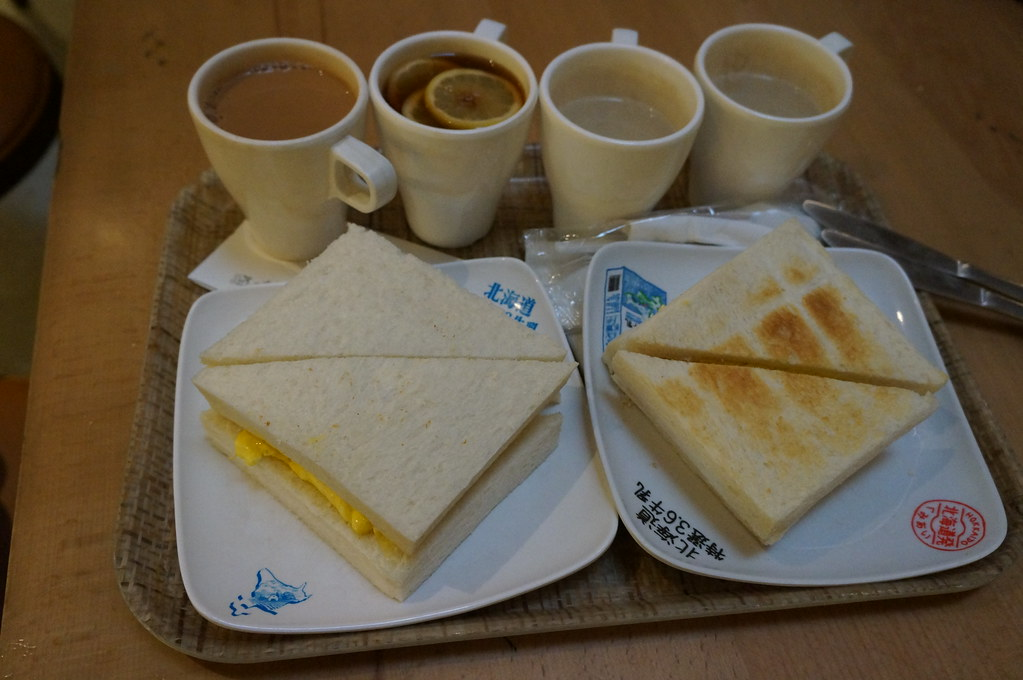 Hong Kong must eat: Egg sandwiches and tea for a snack at Hokkaido Dairy Farm Restaurant. Image: RosieTulips, CC.