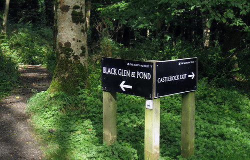 Signs leading to the Black Glen at Downhill Demesne in Ireland, UK