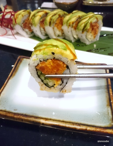 Chopstick holding up Spicy Caterpillar Roll