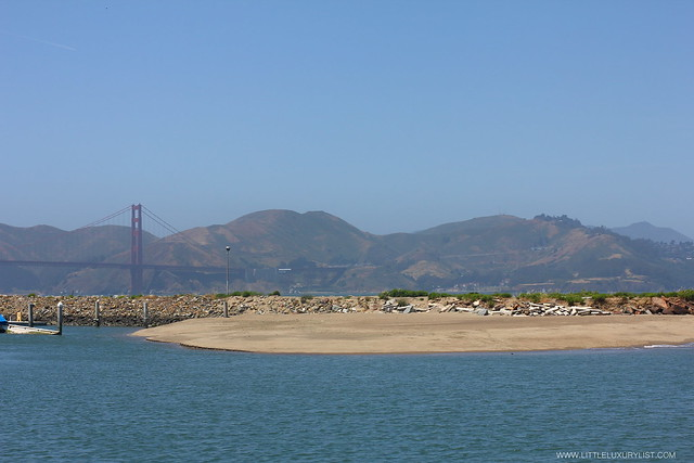 San Francisco Golden Gate in background by little luxury list